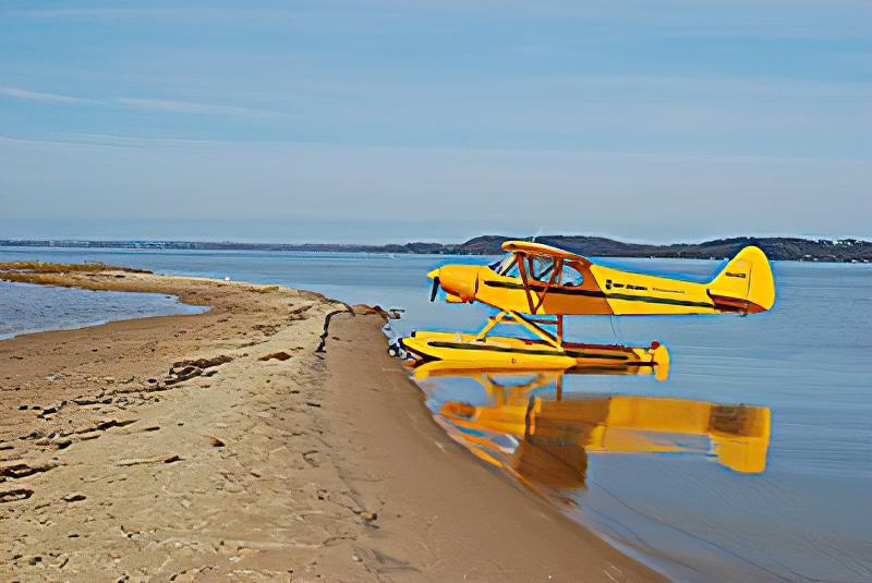 NMC Aviation float plane on beach