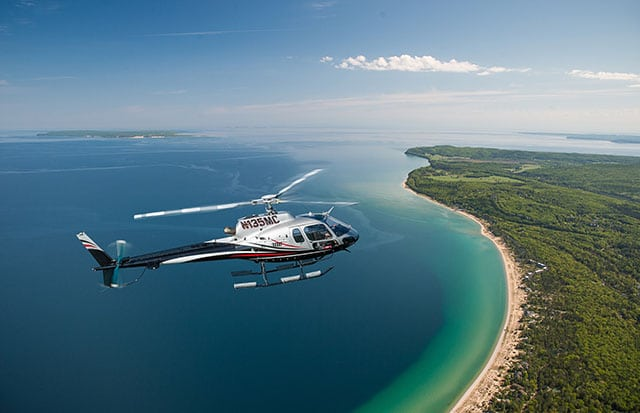 Helicopter over Lake Michigan shoreline