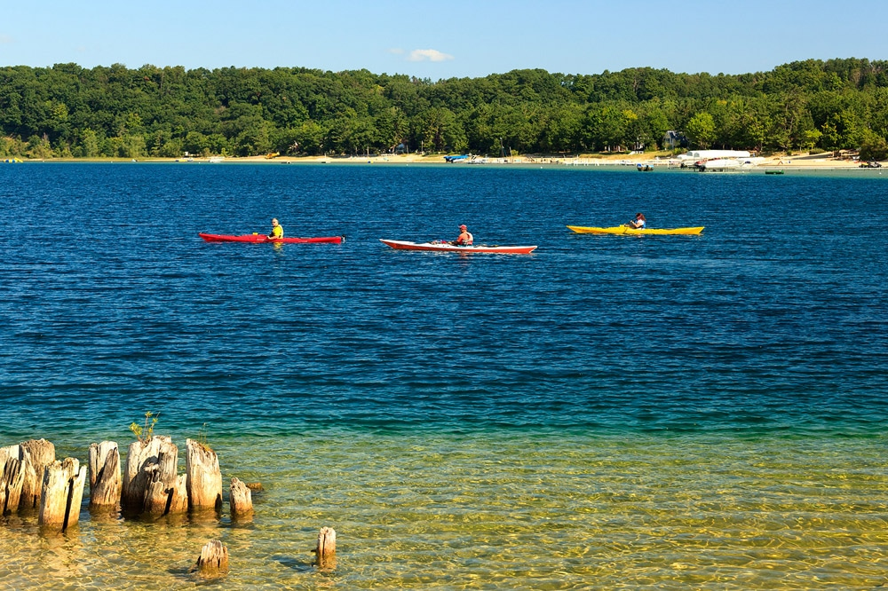 3 kayaks on West Grand Traverse Bay