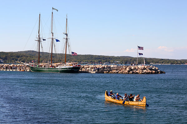 historic canoe and tall ship in Traverse City harbor