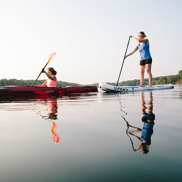 Kayaking and paddle boarding on a lake