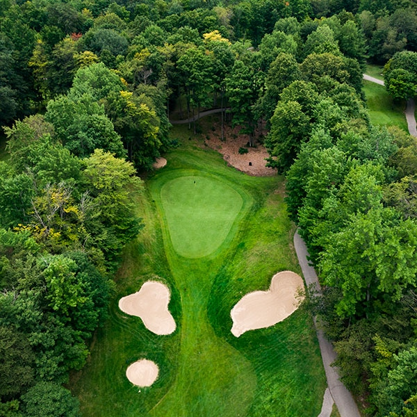 Aerial view of golf green and sand traps