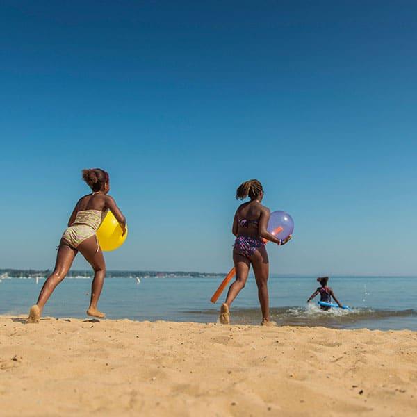 young girls running at beach